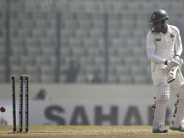 Bangladesh's captain Mushfiqur Rahim is bowled out against Sri Lanka during the fourth day of their first Test in Dhaka. (Reuters Photo)