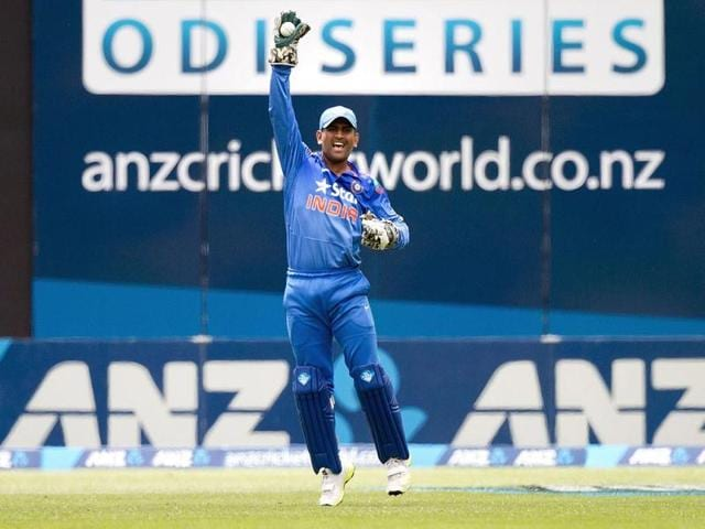 MS Dhoni celebrates taking a catch off of Martin Guptill of New Zealand but was given not out during their fifth and final ODI in Wellington. (AFP Photo)