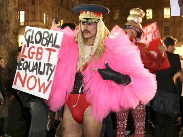 A-gay-rights-protester-rallies-against-Russia-s-anti-gay-stance-outside-Downing-Street-central-London-Reuters-photo