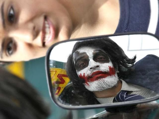 Why so serious? A man dressed up as Joker from The Dark Knight series looks at the mirror (Raj K Raj/HT)