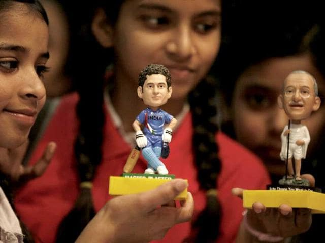 Students hold Sachin Tendulkar and Mahatma Gandhi miniatures (Raj K Raj/HT)
