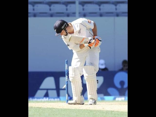 New Zealand's BJ Watling looks back on his stumps after being bowled for 11 by Ishant Sharma on the 3rd day of the 1st Test at Eden Park in Auckland. (AP Photo)