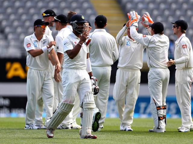New Zealand celebrate the wicket of Cheteshwar Pujara (C) during day four of the first Test against India at Eden Park in Auckland. (AFP Photo)