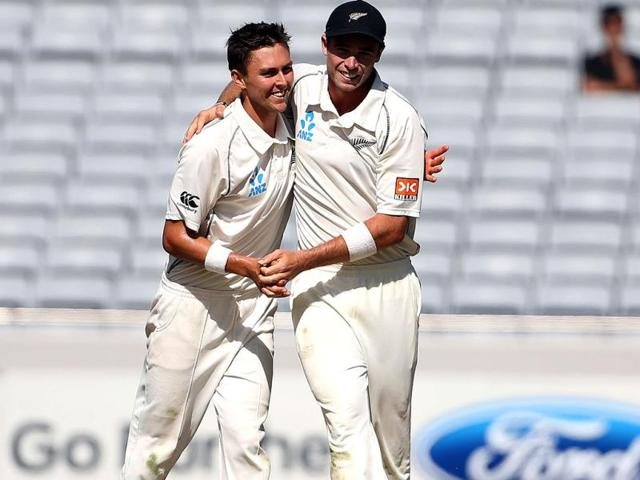 Trent Boult and Tim Southee (R) of New Zealand celebrate the wicket of Ravindra Jadeja during day four of the first Test against India at Eden Park in Auckland. (AFP Photo)