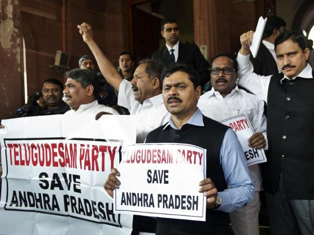 TDP-MPs-shout-slogans-against-the-UPA-govt-and-Sonia-Gandhi-during-a-protest-calling-for-a-united-Andhra-Pradesh-outside-the-Parliament-AFP-Photo