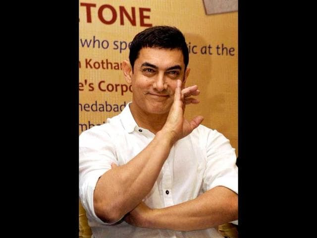 Aamir-Khan-poses-for-a-photograph-during-the-launch-of-Sagar-Movietone-written-amp-compiled-by-Biren-Kothari--in-Mumbai-on-late-February-11-2014-AFP-Photo