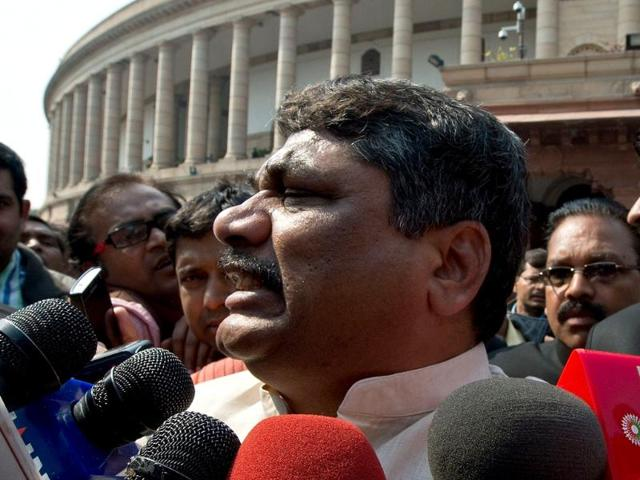 Telugu Desam Party (TDP) MP Venugopal Reddy talks (C) to the media following scuffles inside the building disrupted Parliament. (AFP Photo)