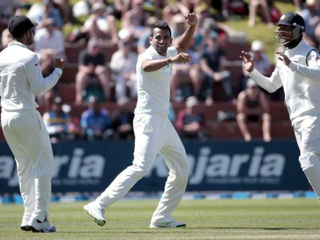 Zaheer Khan (C) celebrates the wicket of New Zealand