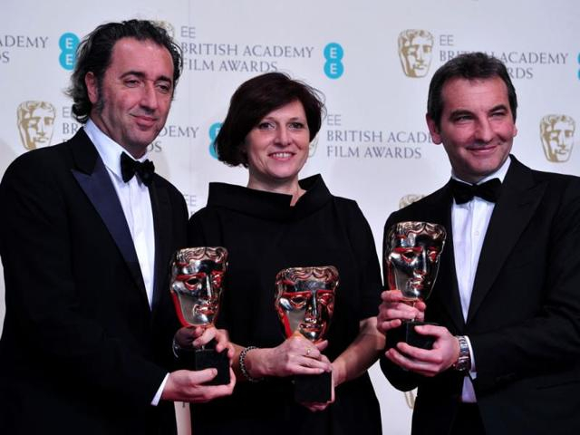 Italian-director-and-writer-Paolo-Sorrentino-and-Italian-producers-Nicola-Giuliano-and-Francesca-Cima-pose-with-the-award-for-a-film-not-in-the-English-language-for-The-Great-Beauty-at-the-BAFTA-British-Academy-Film-Awards-at-the-Royal-Opera-House-in-London-on-February-16-2014-AFP-Photo