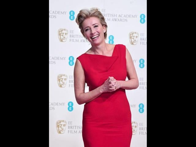Emma-Thompson--arrived-in-a-white-coat-and-later-posed-in-a-fitted-red-dress