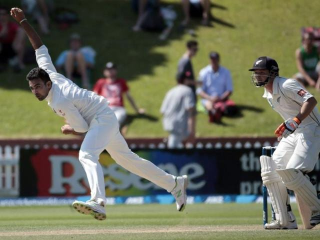 Zaheer Khan (L) bowls in the New Zealand second innings on day four of the second Test at the Basin Reserve in Wellington. (Reuters Photo)