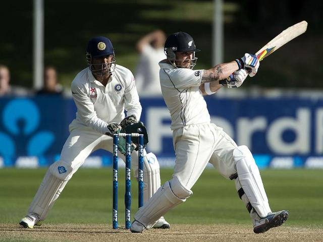 Brendon McCullum (R) of New Zealand bats as MS Dhoni looks on during Day 4 of the 2nd Test at the Basin Reserve in Wellington. (AFP Photo)