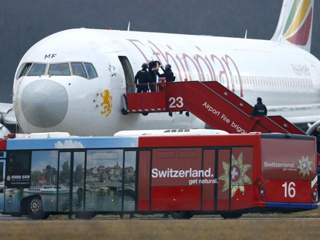 Police-officers-help-a-passenger-disembark-hijacked-Ethiopian-Airlines-flight-ET-702-at-Cointrin-airport-in-Geneva-Reuters-photo
