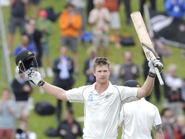 New Zealand's James Neesham celebrates his century on debut against India on the final day of the second Test at the Basin Reserve in Wellington. (AP Photo)