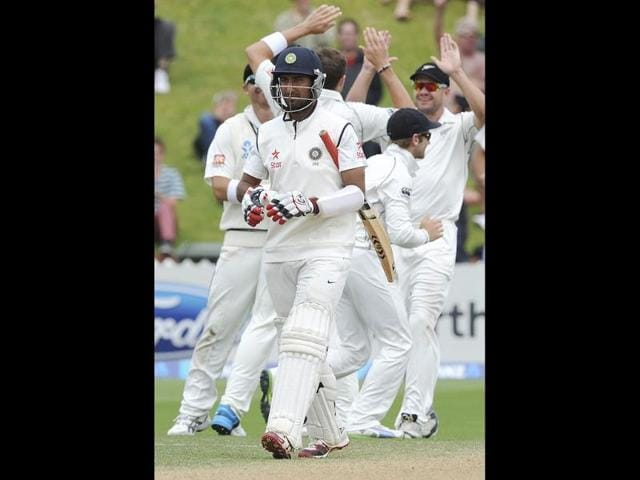 Cheteshwar Pujara is out for 17 off the bowling of New Zealand's Tim Southee on the final day of the second Test at the Basin Reserve in Wellington. (AP Photo)