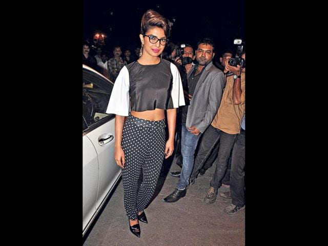 Priyanka Chopra: The Bollyood actor went retro with a black boxy top paired with polka-dot pants at a recent press meet. A pink pout and cat-eye glasses brought her quirky side out.