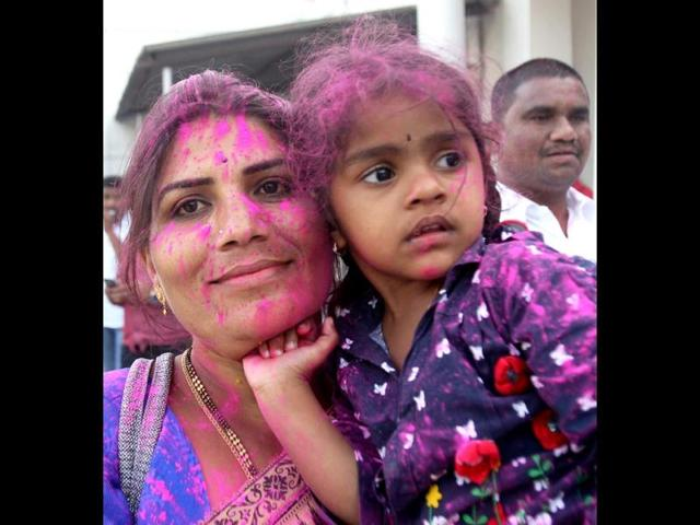 TRS supporters celebrate with colours the passage of Telangana bill in the Lok Sabha in New Delhi. (PTI photo)