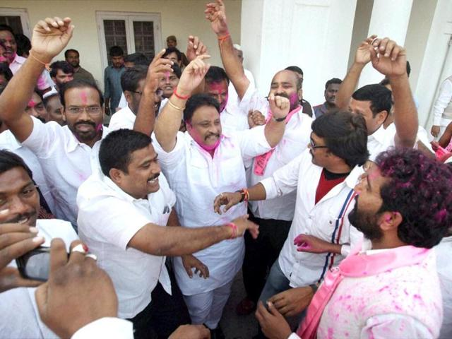 TRS activists dance as they celebrate with colours the passage of Telangana bill in the Lok Sabha, in New Delhi. (PTI photo)