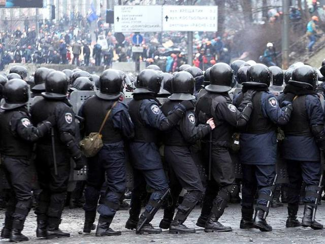 Riot police face anti-government protesters during clashes central Kiev. Ukraine