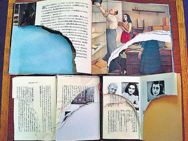 Ripped-pages-of-three-books-of-Anne-Frank-s-Diary-of-Young-Girl-are-displayed-at-a-library-in-Tokyo-AFP-photo