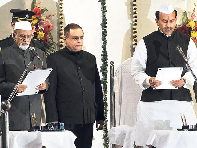 Governor-Syed-Ahmed-administers-the-oath-of-office-to-KN-Tripathi-at-Raj-Bhavan-in-Ranchi-on-Friday-Parwaz-Khan-HT-photo