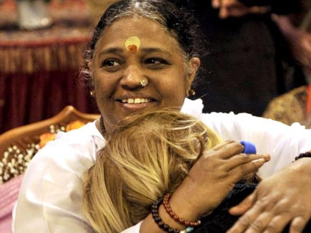Spiritual-leader-Mata-Amritanandamayi-L-aka-Amma-Mother-hugs-a-woman-in-this-October-31-2012-file-photo-in-Toulon-southeastern-France-for-a-few-days-trip-in-France-AFP-Photo