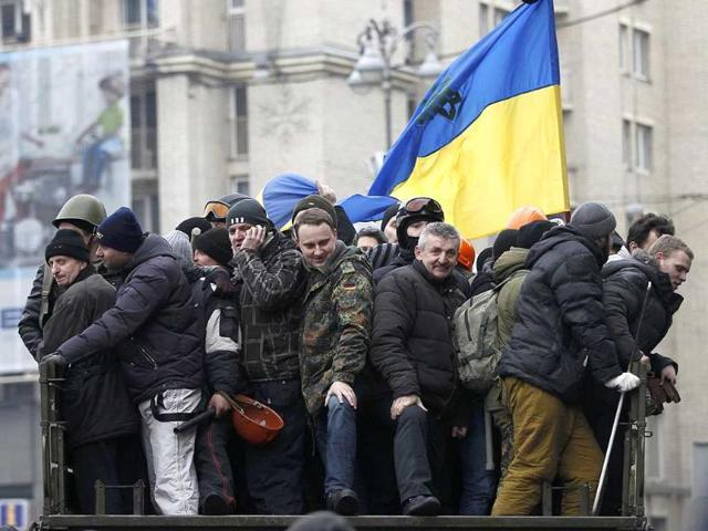 Anti-government protesters are transported in a truck in the Independence Square in Kiev. (Reuters Photo)