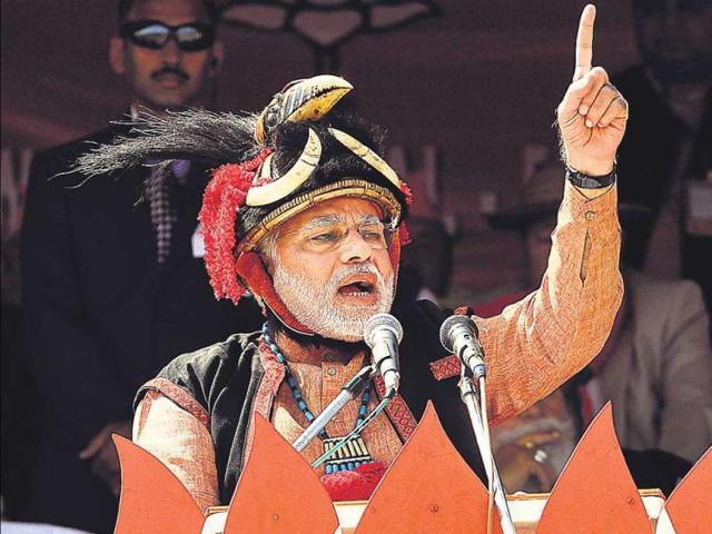Narendra-Modi-dressed-in-the-traditional-attire-and-headgear-of-Arunachal-s-Adi-tribe-at-a-rally-in-Pasighat-on-Saturday-The-BJP-s-PM-candidate-claimed-to-have-roots-in-the-tribe-s-Modi-clan-AP-Photo--