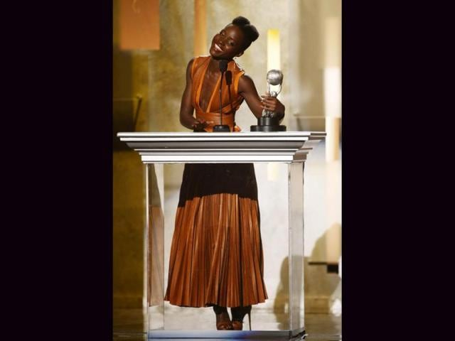 Actress-Lupita-Nyong-o-accepts-the-outstanding-supporting-actress-in-a-motion-picture-award-for-the-film-12-Years-a-Slave-during-the-45th-NAACP-Image-Awards-in-Pasadena-California-Reuters-