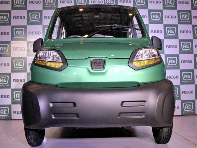 Bajaj-s-managing-director-Rajiv-Bajaj-is-seen-through-the-windows-of-the-newly-launched-four-wheeled-RE60-in-New-Delhi-in-this-January-3-2012-file-photo-REUTERS-B-Mathur-Files