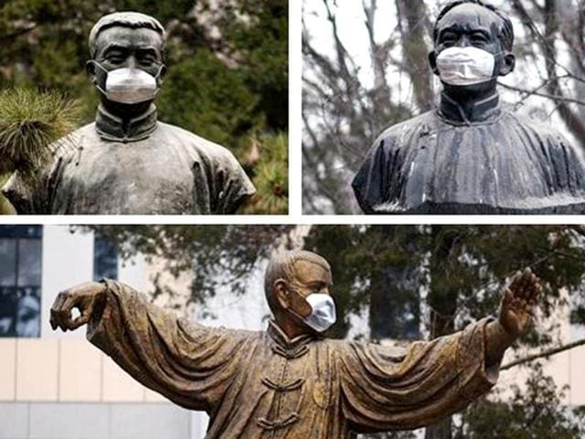 Statutes of founding leaders of the Communist Party of China and leading economists were masked at the prestigious Peking University as a mark of protest against pollution. (Photo courtesy: China Foto Press)