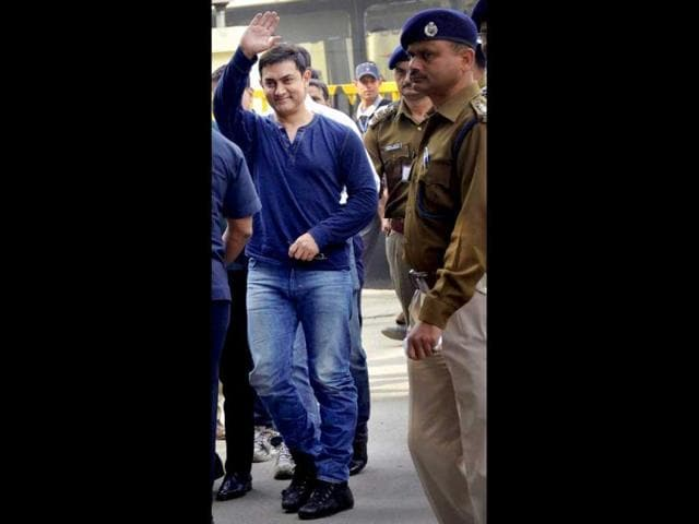Bollywood actor Aamir Khan arrives at Patna airport on Tuesday to promote his TV show Satyamev Jayate. (PTI Photo)