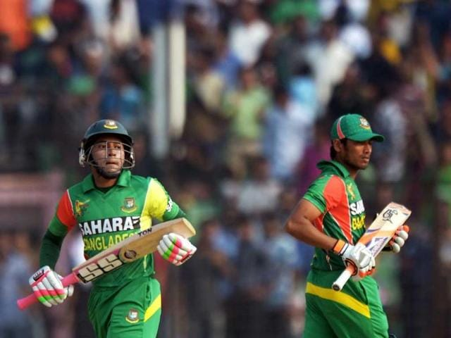 Bangladeshi cricketers Anamul Hoque Bijoy (R) and Mushfiqur Rahim complete a run during the second match of the Asia Cup against India at the Khan Shaheb Osman Ali Stadium in Fatullah. (AFP Photo)