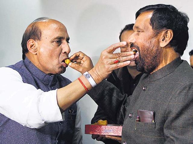 Lok-Janshakti-Party-president-Ramvilas-Paswan-being-offered-sweets-by-BJP-chief-Rajnath-Singh-after-their-alliance-in-New-Delhi-PTI-photo