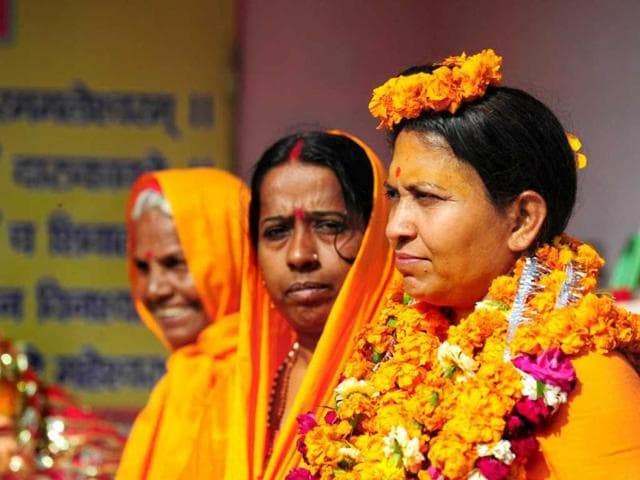India-s-first-women-akhara-s-Pithadhishwar-Jagat-Guru-Shankaracharya-Shri-Sadguru-Trikaal-Bhawanta-L-stands-with-her-disciples-outside-her-Temple-in-Allahabad-AFP-photo
