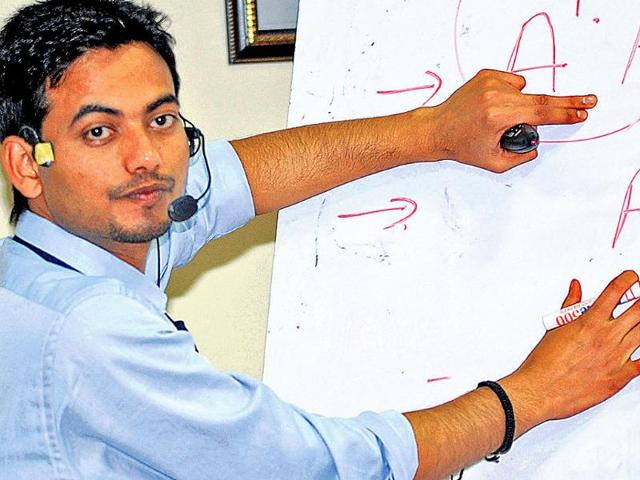 Assistant-professor-Arvind-Mishra-on-the-first-day-of-his-during-his-5-day-non-stop-lecture-in-Dehradun-on-Saturday-Rish-Ballabh-Hindustan-Times