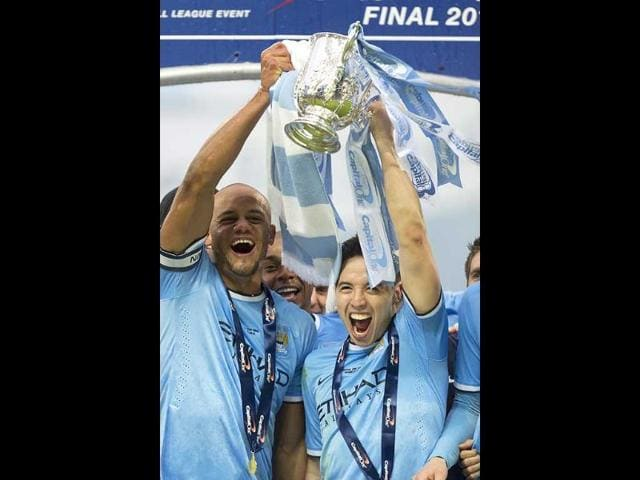 Manchester-City-captain-Vincent-Kompany-L-and-Samir-Nasri-celebrate-after-their-team-s-3-1-win-against-Sunderland-in-the-League-Cup-Final-at-Wembley-Stadium-London-AP-Photo