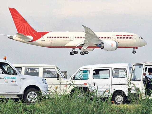 Air India flight,Air India flight catches fire,Emergency landing
