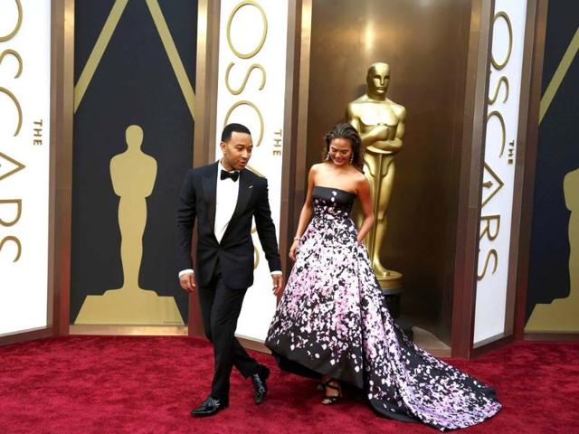 Singer-John-Legend-and-a-model-arrive-at-the-Oscar-2014-red-carpet-Reuters-photo