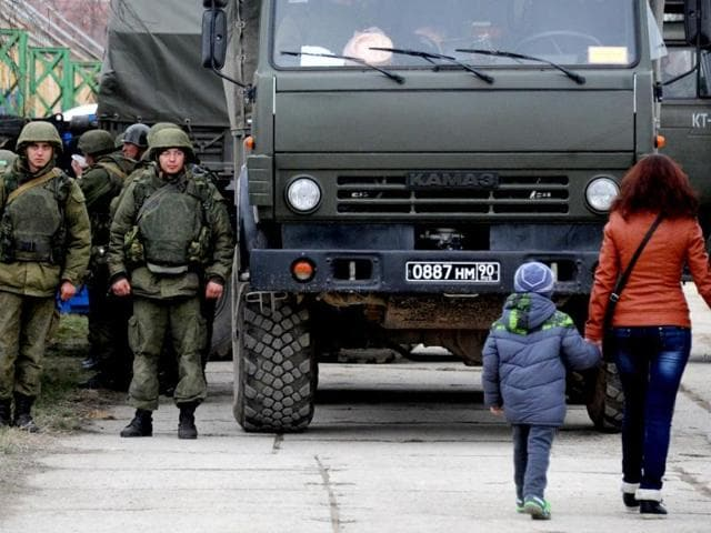 Military-personnel-stand-near-a-Russian-made-Kamaz-truck--in-the-eastern-Crimea-port-city-of-Feodosiya-AFP-Photo