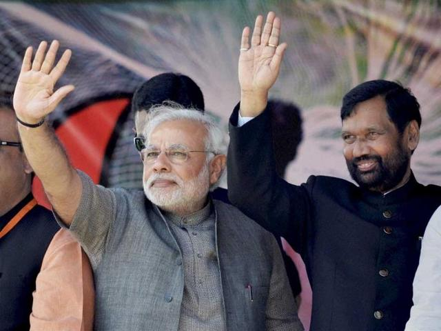 BJP-s-PM-candidate-Narendra-Modi-waves-during-an-election-road-show-in-Varanasi-PTI-photo