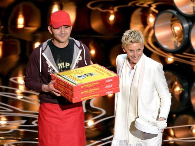 Oscar-host-Ellen-DeGeneres--with-pizza-delivery-man-Edgar-Martirosyan--on-stage-at-the-Dolby-Theatre-on-March-2-2014-in-Hollywood-California-AFP-Photo