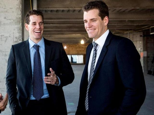 A-file-photo-of-entrepreneurs-Cameron-Winklevoss-and-brother-Tyler-Winklevoss-walk-around-the-68th-floor-of-Four-World-Trade-Center-in-New-York-City-AFP-photo