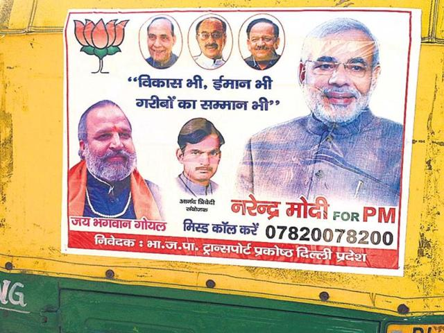 A-poster-of-BJP-s-PM-candidate-Narendra-Modi-on-an-auto-rickshaw-in-New-Delhi-HT-photo