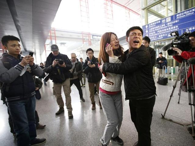 A relative of a passenger onboard crashed Malaysia Airlines jet, cries at the Beijing Capital International Airport in Beijing. (Reuters)