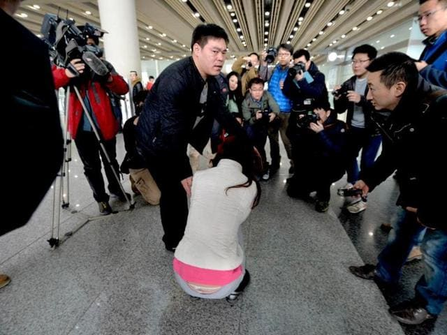A possible relative cries at the Beijing Airport after news of the missing Malaysia Airlines Boeing 777-200 plane in Beijing. (AFP photo)