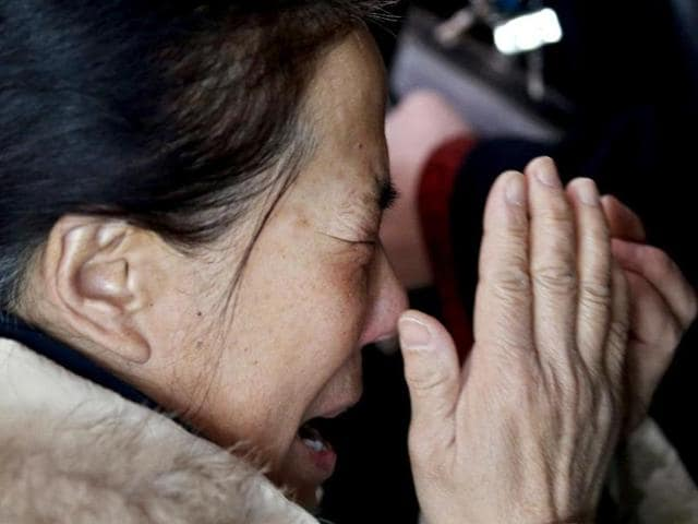 A relative of a passenger onboard Malaysia Airlines flight MH370 cries at the Beijing Capital International Airport in Beijing. (AFP photo)