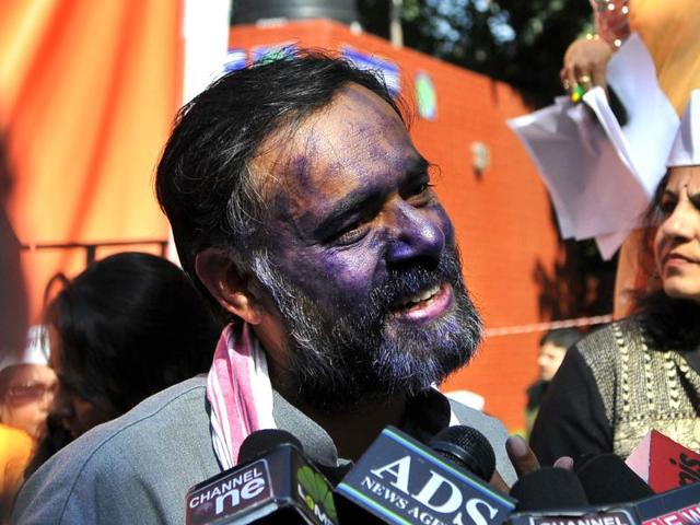 An-unknown-person-suddenly-threw-ink-on-Aam-Aadmi-Party-leader-Yogendra-Yadav-s-face-at-AAP-women-s-rally-on-International-Women-s-Day-at-Jantar-Mantar-in-Delhi-India-on-Saturday-March-8-2014--Subrata-Biswas-HT