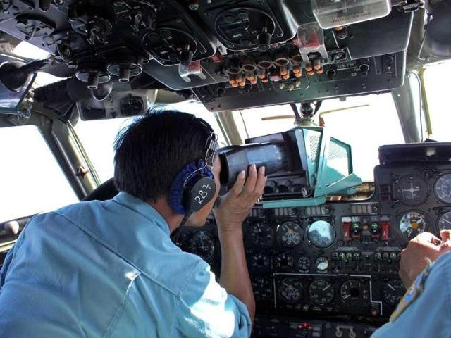 This-picture-taken-on-March-8-2014-shows-military-personnel-scanning-the-sea-aboard-a-Vietnamese-Air-Force-aircraft-taking-part-in-a-search-mission-for-a-missing-Malaysia-Airlines-aircraft-somewhere-between-Malaysia-s-east-coast-and-southern-Vietnam-AFP-Photo