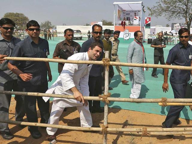 Congress-vice-president-Rahul-Gandhi-C-surrounded-by-his-security-personnel-speaks-to-his-supporters-through-a-barricade-after-addressing-a-rally-at-Balasinor-in-Gujarat-Reuters-photo